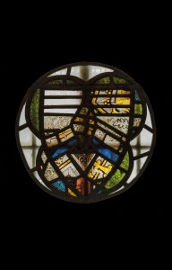 Picture showing the fragments of glass in the old baptistry rotated to reveal a shield shape within the construction