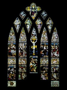 CE Kempe stained glass in the Chancel, 1883. The great east window depicting the crucifixion and events after the resurrection.
