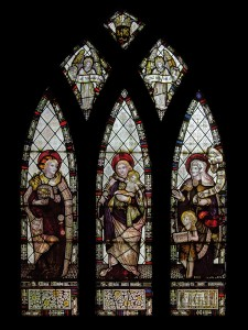 CE Kempe stained glass in the chancel, 1888. St Mary Magdalene, the Virgin Mary and St Elizabeth.