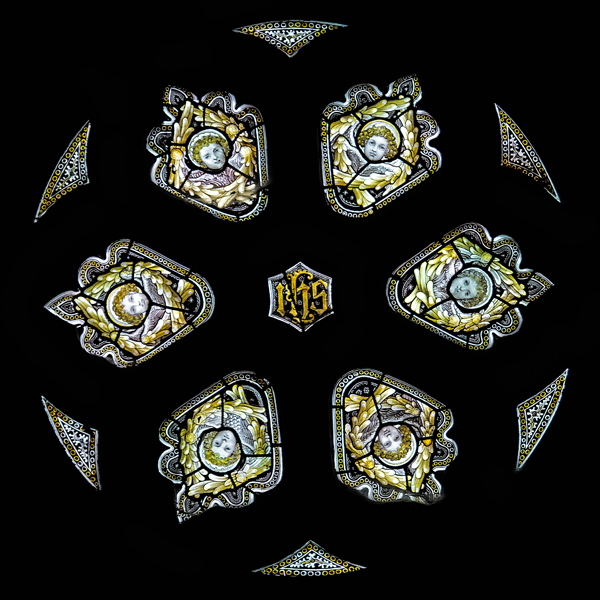 CE Kempe stained glass in the cancel arch, 1895. Six angel heads.