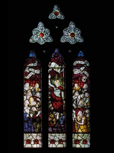 CE Kempe stained glass in the south transept, 1894. Christ breaks down the gates of Hell.