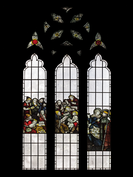 Fire-damaged CE Kempe stained glass in the north transept, 1892. Jesus as a boy in the Temple.
