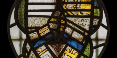 Fragments of early glass, mounted in a roundel and placed onto one of the baptistry windows.
