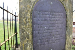 Commemorative panel on Ben Caunt's grave