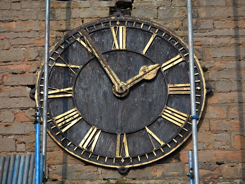 West face of clock showing corrosion and loose or missing mounts