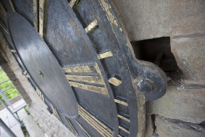 Close up of unsecured clock face mounting bolt