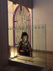 St Mary Magdalene stained glass image on new glass partition screen in south transept
