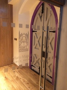 New lobby area in south transept and glass doors with frosted logo