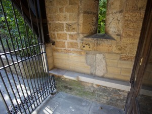 Repaired porch showing repositioned headstone