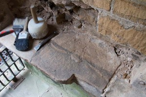 Main door porch area stonework discovery of headstone?