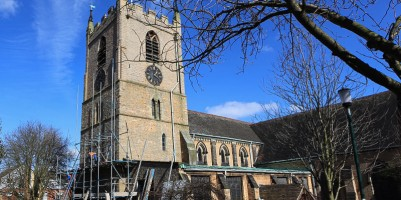 The church tower before restoration work started, scaffolding starting to be erected