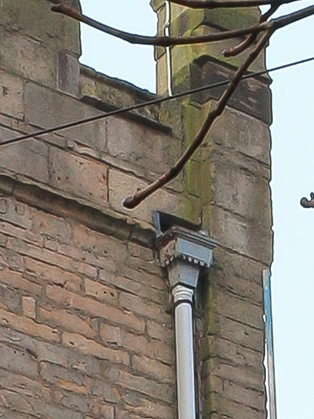 Close up of old drainage to north face of tower