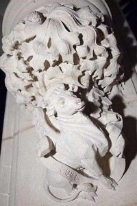 Close up of a stone carving representing St Luke