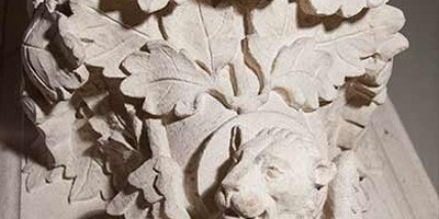 Close up of a stone carving representing St Mark