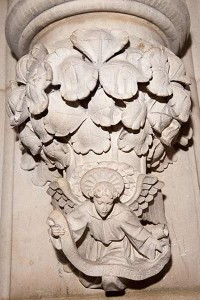 Close up of a stone carving representing St Matthew