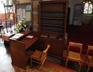 The new bookcase and stewards welcome desk at the back of church