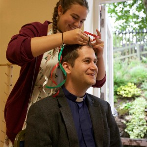 New curate James Pacey 'having a makeover' at the Burundi Sunday event