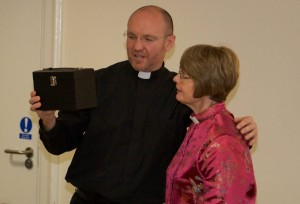 Sergiy receiving a gift from the church and parishioners at his leaving party