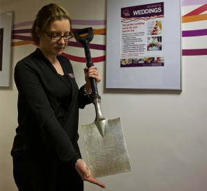 Kim Pears, Centre Manager at the John Godber Centre, holding the spade presented to Canon John Godber in 1906