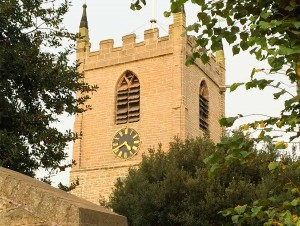 The newly repointed church tower with scaffolding finally removed