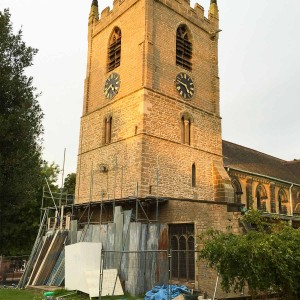 The newly repointed church tower with scaffolding being removed