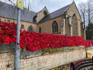 Hand-knitted poppies outside St Mary Magdalene Church, Hucknall, Nottinghamshire