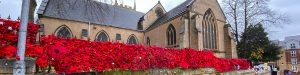 Display of knitted poppies outside St Mary Magdalene church, Hucknall, 2020